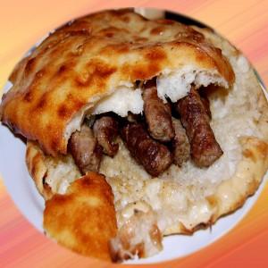 Skinless Sausages in Flat Bread with Kaymak (Ćevapi u lepinji sa kajmakom)